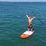 Happy man StandUP Paddleboarding
