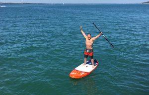 Happy man StandUP Paddleboarding
