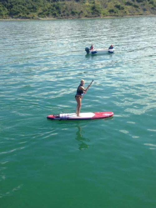 Woman StandUp Paddleboarding